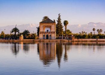 Saadian pavilion,Menara gardens and Atlas in Marrakech, Morocco, Africa at sunset. Water reflection.